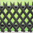 Wooden fence with lattice — Stock Photo