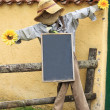 Scarecrow with whiteboard — Stock Photo