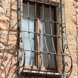 Medieval window with grate — Stockfoto #15773109