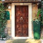 Renaissance front door with roofing — Stock Photo