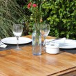 Table setting in a garden - Stock Photo