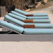 Deckchairs in beach — Stock Photo #19564029