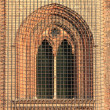 Medieval window with grate — Stockfoto