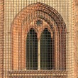 Medieval window with grate — Stock fotografie