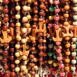 Colorful beads with tau cross — Stock Photo