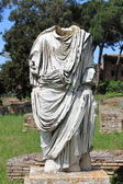 Beheaded statue of a roman senator — Stock Photo