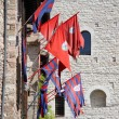Flags of districts in the medieval town of Assisi - Stock Photo