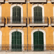 Arched windows with balcony — Stock Photo #22668331