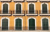 Arched windows with balcony — Stock Photo