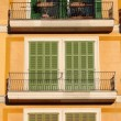 Squared windows with balcony — Stock Photo #23120848