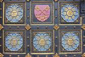 Wooden door with emblems — Stock Photo