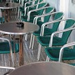 Stock Photo: Row of bar tables and chairs