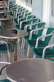 Row of bar tables and chairs — Stock Photo