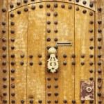 Wooden door with arab style doorknob — Stock Photo