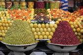 Fresh olives and bottled food — Stock Photo