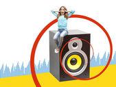 Girl sitting on a musical loudspeaker — Stock Photo