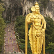 Statue of lord Muragan outside the Batu caves. - Stock Photo
