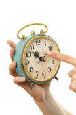 Old alarm clock in hands — Stock Photo