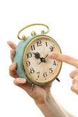 Antigo relógio despertador nas mãos — Foto Stock