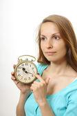 Mujer con reloj despertador — Foto de Stock
