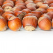 Stock Photo: Hazelnuts on white surface