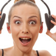 Woman listening music with headphones, on white — Stock Photo #27374907