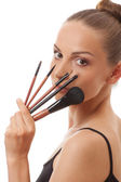 Young woman showing her makeup brushes — Stock Photo