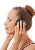 Woman listening music with headphones, on white — Stock Photo