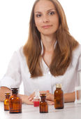 Woman doctor with medication in glass bottles — Stock Photo