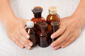 Doctor's hand with bottles of medicine — Stock Photo