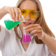 Woman chemist and chemicals in flasks — Stockfoto