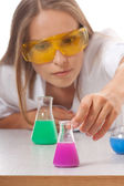 Woman chemist and chemicals in flasks — Photo