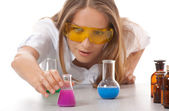 Woman chemist and chemicals in flasks — Стоковое фото