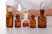 Doctor's hand with bottles of medicine — Foto Stock