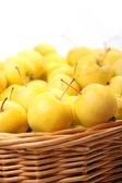 Yellow apples in a wicker basket — Stock Photo