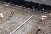 Workers make reinforcement for concrete foundation — Stok fotoğraf