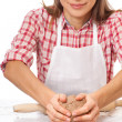 Smiling woman chef holding dough in the hands — Stock Photo #36503019