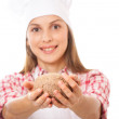 Smiling woman chef holding dough in the hands — Stock Photo #36805731