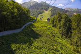Cable car in summer mountains — ストック写真