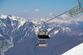 Chairlift on a ski resort — Stock Photo