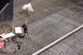 Workers make reinforcement for concrete foundation — Foto Stock