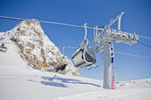 Chairlift in a ski resort ( Sochi, Russia ) — Stock Photo