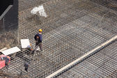 Workers make reinforcement for concrete foundation — Stock Photo