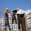 Stock Photo: SOCHI, RUSSIA - JUNE 18, 2012: Workers make reinforcement for concrete wall