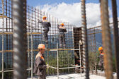SOCHI, RUSSIA - JUNE 18, 2012: Workers make reinforcement for concrete wall — Stock Photo