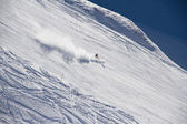 Skier going down the slope at ski resort. — Stock Photo