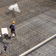 Workers make reinforcement for concrete foundation — Stock Photo #41253403