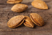 Almonds on wooden board — Stock Photo