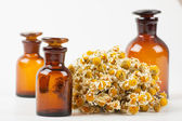 Dry chamomile and a bottles — Stock Photo
