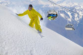 Snowboard rider moving down in snow powder — Stock Photo
